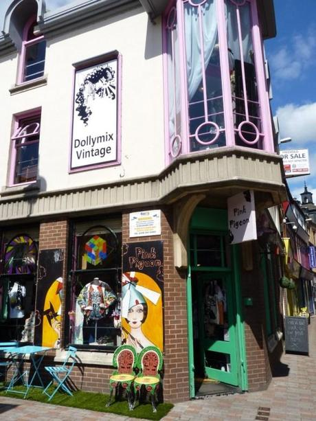 vintage shops in the lanes leicester pink pigeon dollymix vintage fake grass outside sunny summer chairs