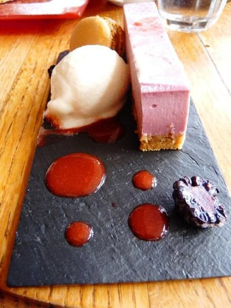 blackberry cheesecake with apple macaron and sorbet slate plate mrs bridges leicester