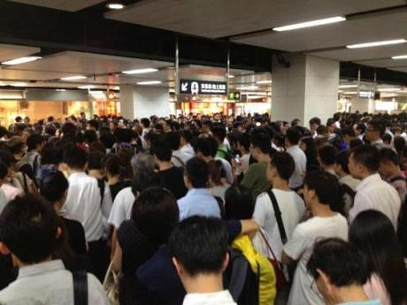 MTR passengers stranded during Typhoon Vincente in 2012. Image Source: Dan Leach