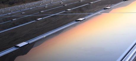 A view of the sunset reflecting in a solar panel. (Credit: Flickr @ Thomas Galvez http://www.flickr.com/photos/togawanderings/)