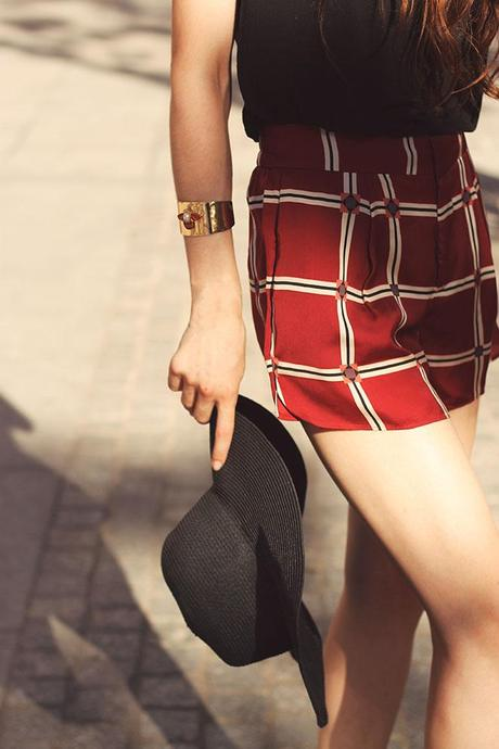 details from the plaid shorts look wearing bee bracelet and floppy hat