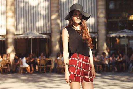 plaid shorts look with floppy hat and black top