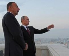 Russian President Vladimir Putin, right, gestures to Azerbaijan's President Ilham Aliyev as they walk along an embankment in Baku, Azerbaijan on Tuesday, Aug. 13, 2013. (AP/RIA Novosti Kremlin/Mikhail Klimentyev/Presidential Press Service)