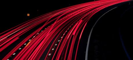 An electric road will consist of a large number of electrically conductive tapes—like the light trails on a night road. (Credit: Flickr @ Michael Rammell http://www.flickr.com/photos/mikerammell/)