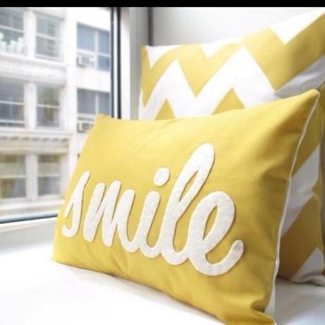 smile pillow Extend Summer with Pops of Yellow in Your Decor!