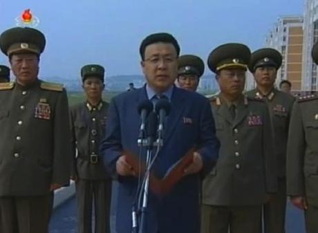 Chief Secretary of the Pyongyang KWP Committee Mun Kyong Dok C) speaks during the ceremony opening the U'nha Scientists' Street.  Also seen in attendance are Minister of People's Security Choe Pu Il (L) and President of the Second Academy of Natural Sciences Choe Chun Sik (R) (Photo: KCTV screengrab).