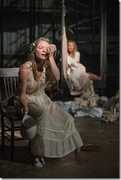 Rosa (Chaon Cross) cools herself with a wet cloth in Steppenwolf Theatre Company's American-premiere production of The Wheel by Zinnie Harris, directed by ensemble member Tina Landau.  (photo credit: Michael Brosilow)