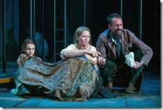 (right to left) Rossignol (Mark L. Montgomery) shares his apricots with Beatriz (ensemble member Joan Allen) and The Girl (Emma Gordon) in Steppenwolf Theatre Company's American-premiere production of The Wheel by Zinnie Harris, directed by ensemble member Tina Landau.  (photo credit: Michael Brosilow)