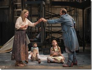 Beatriz (ensemble member Joan Allen, left) is paid to help a soldier (ensemble member Tim Hopper, right) as The Boy (Daniel Pass) and The Girl (Emma Gordon) look on in Steppenwolf Theatre Company's American-premiere production of The Wheel by Zinnie Harris, directed by ensemble member Tina Landau.  (photo credit: Michael Brosilow)