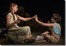 The Girl (Emma Gordon) and The Boy (Daniel Pass) play a game of pattycake in Steppenwolf Theatre Company's American-premiere production of The Wheel by Zinnie Harris, directed by ensemble member Tina Landau. (photo credit: Michael Brosilow)