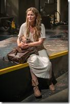 Beatriz (ensemble member Joan Allen) pauses for a moment on her journey, caring for an infant in Steppenwolf Theatre Company's American-premiere production of The Wheel by Zinnie Harris, directed by ensemble member Tina Landau.  (photo credit: Michael Brosilow)