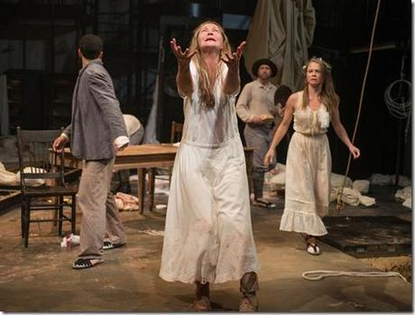 Beatriz (ensemble member Joan Allen, center) pleads for the action to stop moving forward as (left to right) Tomas (Demetrios Troy), Colline (ensemble member Tim Hopper) and Rosa (Chaon Cross) look on in Steppenwolf Theatre Company's American-premiere production of The Wheel by Zinnie Harris, directed by ensemble member Tina Landau.  (photo credit: Michael Brosilow)
