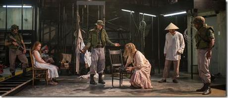 Glennister (ensemble member Tim Hopper, center) insists that Beatriz (ensemble member Joan Allen, center right) must prove that The Girl is miraculous as (left to right) a soldier (Kareem Bandealy), The Girl (Emma Gordon), The Boy (Daniel Pass), Xuan (Demetrios Troy) and Hancock (La Shawn Banks) look on in Steppenwolf Theatre Company's American-premiere production of The Wheel by Zinnie Harris, directed by ensemble member Tina Landau.  (photo credit: Michael Brosilow)