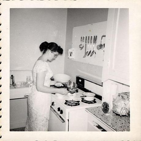 Young woman in kitchen, 1960