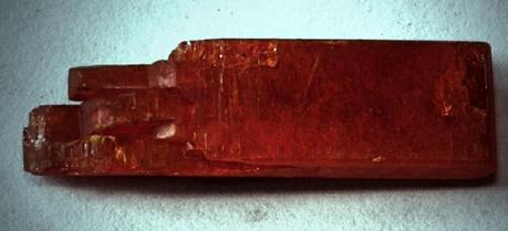 A sample of potassium dichromate, also known as the mineral lopezite. About 10 mm long, probably synthetically grown. (Credit: A13ean, http://commons.wikimedia.org/wiki/User:A13ean)