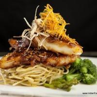 Cavalli Caffe - Chili Caramel Basa, with Wilted Spinach & Wok Tossed Noodles