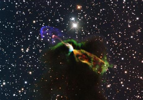 This stunning image of the birth of a star with colorful energetic jets combines both radio and visible light observations from some of the largest telescopes in the wolrd in Chile.   Credit: ESO/ALMA (ESO/NAOJ/NRAO)/H. Arce. Acknowledgements: Bo Reipurth