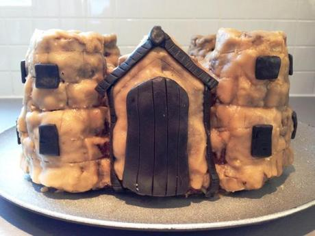 malory towers enid blyton castle cake with black chocolate fondant details front door surround and windows