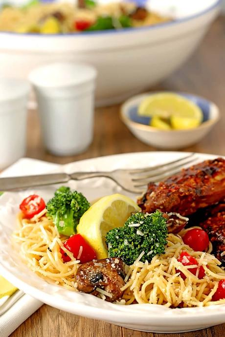 Pasta with Broccoli, Mushrooms, Tomatoes and Parmesan Cheese