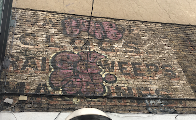 Two ghostsigns clinging on to what's left of Holywell Lane, Shoreditch, EC2