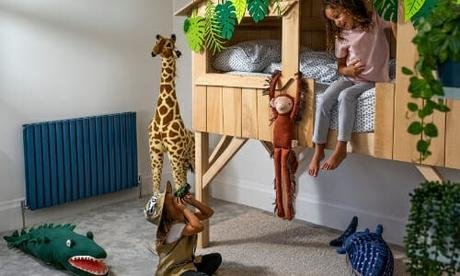 two children in a bedroom with a blue radiator