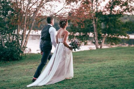 bride and groom walking to the reception