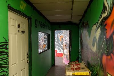 A third, a third, and a third, approximately    Two hallways in 51 Pacific [graffiti]