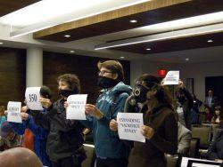 Silent Protest inside the hearing to bring attention to what discussion is being banned from the NEB hearings. Photo Credit: Michael Tolendo