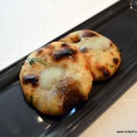 mini kulcha stuffed with caramelised onions and a mild Danish blue cheese