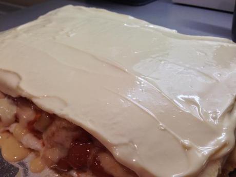 white chocolate topping on caramel apple opera cake layered