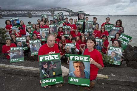 Greenpeace volunteers and staff protest in front of the Auckland Harbour Bridge, New Zealand, in support of the 28  Greenpeace International activists, as well as a freelance photographer and a freelance videographer currently in custody pending investigations into a peaceful Arctic oil protest.