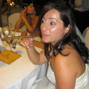 My beautiful sister in law, the only bride I've seen smoking a fat cigar in her wedding gown