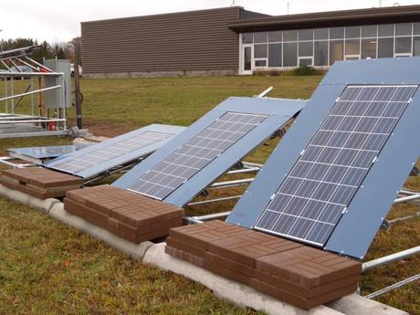 An experimental array of solar panels at Michigan Technological University's Keweenaw Research Center, where it typically snows over 200 inches annually. Researchers aim to determine which angle yields the most electricity over the course of a year.