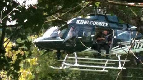 Image: King County, Wash., deputies hover over a suspected gunman Saturday