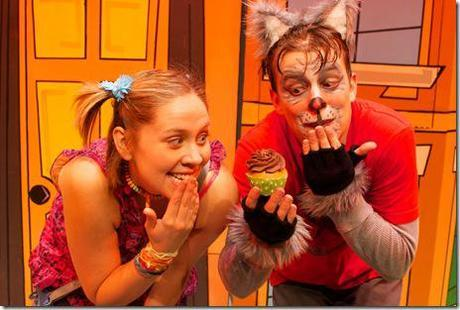 Leah Raidt as Girl and Joe Goldammer as Cat in Emerald City Theatre's If You Give A Cat A Cupcake, adapted and directed by Ernie Nolan. (photo credit: Tom McGrath)