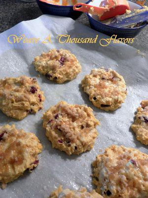 Pumpkin Cranberry Scones - Drizzle brown sugar on scones & rest