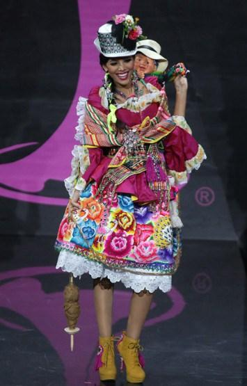 Miss Peru looked colourful and happy yes, but what's with the creepy doll