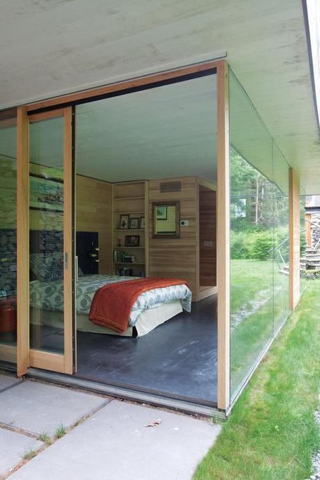 Modern guest bedroom with glass walls