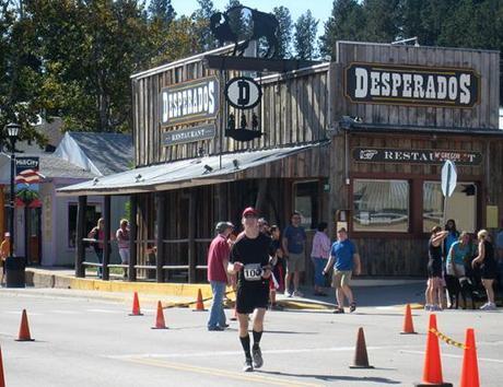 Mike Sohaskey approaching finish of Run Crazy Horse Marathon 2011