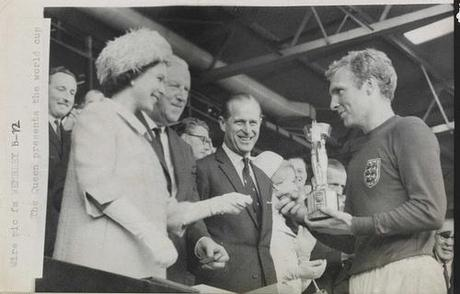 The Queen presents the 1966 World Cup to England Captain, Bobby Moore.