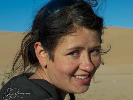 Laurel Robbins covered in sand after sandboarding