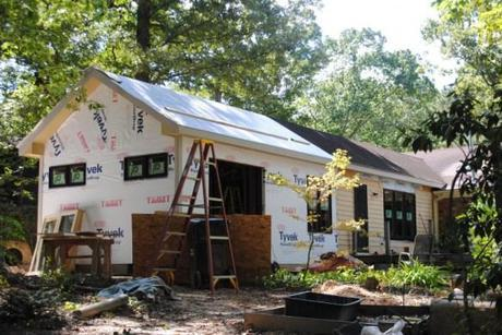 The new addition with windows installed and wall and roof sheathing.