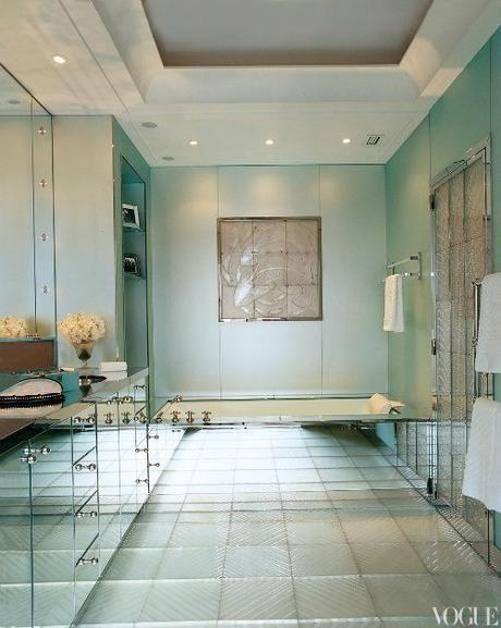|Residential  interiors that are inspiring with its color scheme|master bathroom decorated in glass paneling and green painted walls.