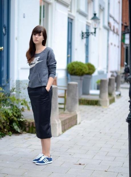 outfit wearing adidas gazelle sneakers leather pencil skirt