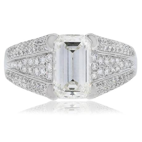 Platinum engagement ring with Emerald cut diamond and micropave band