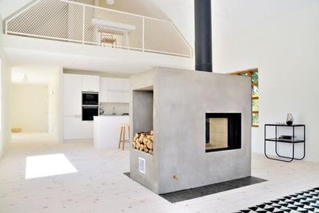 Lofty Swedish house with a concrete fireplace by Sandell Sandberg 2