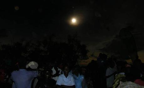 People watching hybrid solar eclipse Uganda, Pokwero