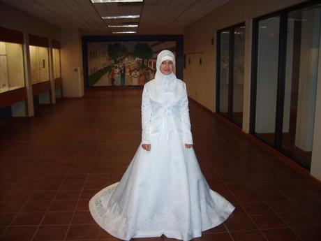 Muslim bride in traditional white dress