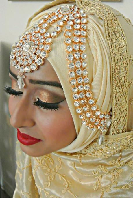 Muslim bride wearing elaborate hijab