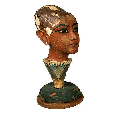 Head statue of Tutankhamen as Sun-god emerging from a Lotus